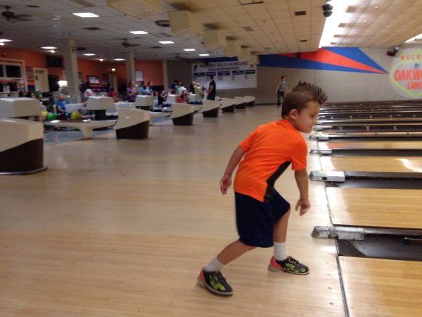 Greyson heaving the ball down the lane